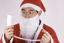 Free Asian Santa Claus With Telephone Stock Images - 1614574