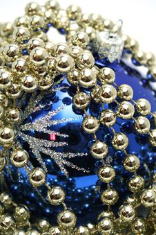 Blue Glass Sphere And Celebratory Beads On A White Stock Photography