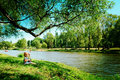 Free Happy Girl Sitting On River Bank Royalty Free Stock Images - 16102179