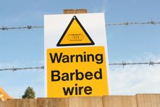 Free Barbed Wire Warning Sign Royalty Free Stock Image - 16101416