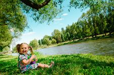 Free Happy Girl Sitting On River Bank Royalty Free Stock Image - 16102226