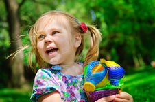 Free Pretty Girl Holding New Toys For Sandbox Outdoor Royalty Free Stock Images - 16102289