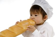 Free Baby Biting Baguette Stock Photo - 16102700