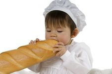 Baby Biting Baguette Stock Photography