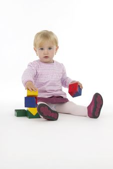 Free Little Girl With Wooden Cubes. Royalty Free Stock Images - 16103219