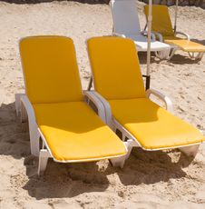 Free Deckchairs On The Beach . Stock Photography - 16114172
