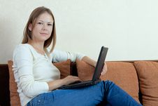 Free Woman With Laptop On The Sofa Royalty Free Stock Image - 16114216