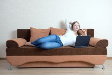 Free Woman With Laptop On The Sofa Royalty Free Stock Image - 16114336
