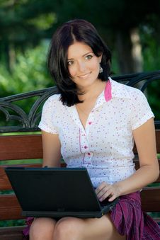 Free Girl With Laptop In Park Royalty Free Stock Photography - 16114377