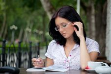 Free Girl With Notepad In Cafe Stock Image - 16114501