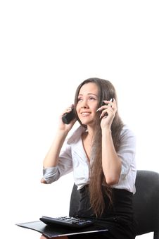 Free Businesswoman Speak By Two Phones Stock Photo - 16115070