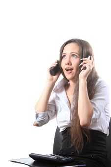 Free Surprised Businesswoman Speak By Two Phones Royalty Free Stock Image - 16115076