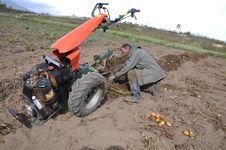 Free Farmer Plowing The Ground Stock Photography - 16119272