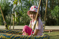 Free Little Girl Smiling On Swing Royalty Free Stock Photo - 16127535