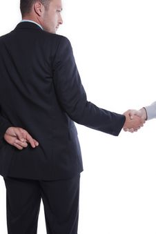 Businessman Shaking Hands, Holding Fingers Crossed Stock Image