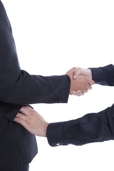 Businessman Shaking Hands, Other Hand In Pocket Stock Photo