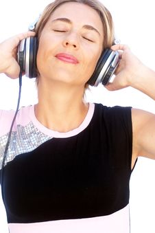 Free Young Woman Listening To Music Royalty Free Stock Photos - 16126288