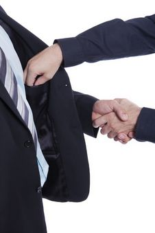 Free Businessman Shaking Hands, Other Hand In Pocket Stock Image - 16126381