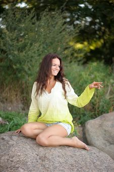 Free Woman Sitting On Stones Royalty Free Stock Photography - 16126447