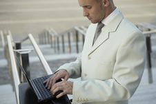 Businessman Portrait With Laptop Stock Photography