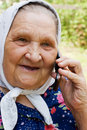 Free Grandmother Talking With A Phone Stock Photography - 16147452