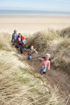 Free Family Walking Along Dunes On Winter Beach Stock Photography - 16147082