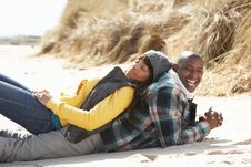 Romantic Young Couple On Winter Beach Stock Images