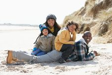 Free Family Sitting On Winter Beach Stock Image - 16147761