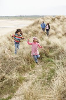 Free Family Walking Along Dunes On Winter Beach Stock Photography - 16148262