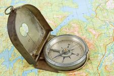 Free Compass On Topographical Map Stock Photo - 16149680