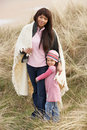 Free Mother And Daughter Wrapped In Blanket Amongst Dun Royalty Free Stock Images - 16150249