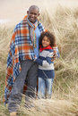 Free Father And Son Wrapped In Blanket Amongst Dunes On Stock Photo - 16150260