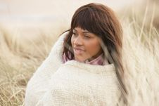 Free Woman Wrapped In Blanket Amongst Dunes On Winter B Royalty Free Stock Image - 16150176