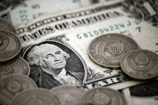 Free THE $1 DOLLAR BILL WITH THE SOVIET COINS ON TOP Stock Photo - 16151250
