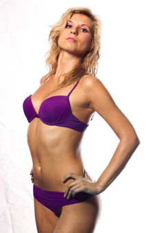 Sexy Girl In A Wet Violet Bikini Stock Photo