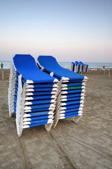 Free Stacked Blue Deckchairs On A Beach Stock Photography - 16153362