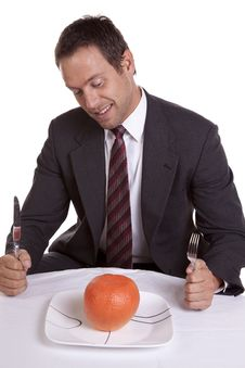 Free Man With Orange On Plate Royalty Free Stock Photo - 16154295