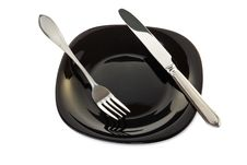 Black Plate With Fork And Knife Royalty Free Stock Photography