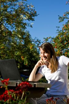 Happy Girl On The Street With A Laptop Royalty Free Stock Photo