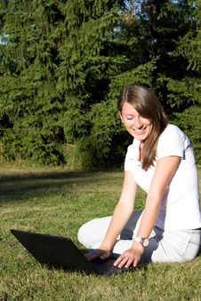 Free Smiling Girl With A Laptop On A Lawn Royalty Free Stock Photography - 16156857