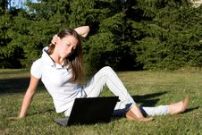 Free Smiling Girl With A Laptop On A Lawn Royalty Free Stock Photos - 16156878