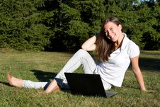 Free Smiling Girl With A Laptop On A Lawn Royalty Free Stock Photos - 16156888