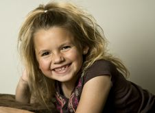 Free Beautiful Young Girl Looking Towards The Viewer Royalty Free Stock Photography - 16157377