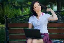 Girl With Laptop In Park Royalty Free Stock Images
