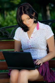 Girl With Laptop In Park Royalty Free Stock Photos