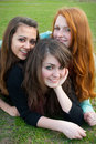 Free Three Different Girls Are Sitting On The Grass And Royalty Free Stock Image - 16163076