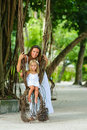 Free Mother And Her Little Daughter In Tropical Park Royalty Free Stock Image - 16169516