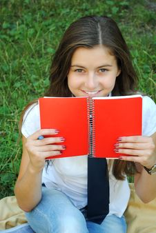 Free Beautiful Young Girl Is Smiling And Carrying Red N Stock Photos - 16163223