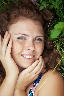 Free Beautiful Ginger Girl Is Lying In The Green Grass Royalty Free Stock Photos - 16163298