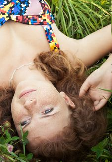 Free Beautiful Ginger Girl Is Lying In The Green Grass Stock Photography - 16163322
